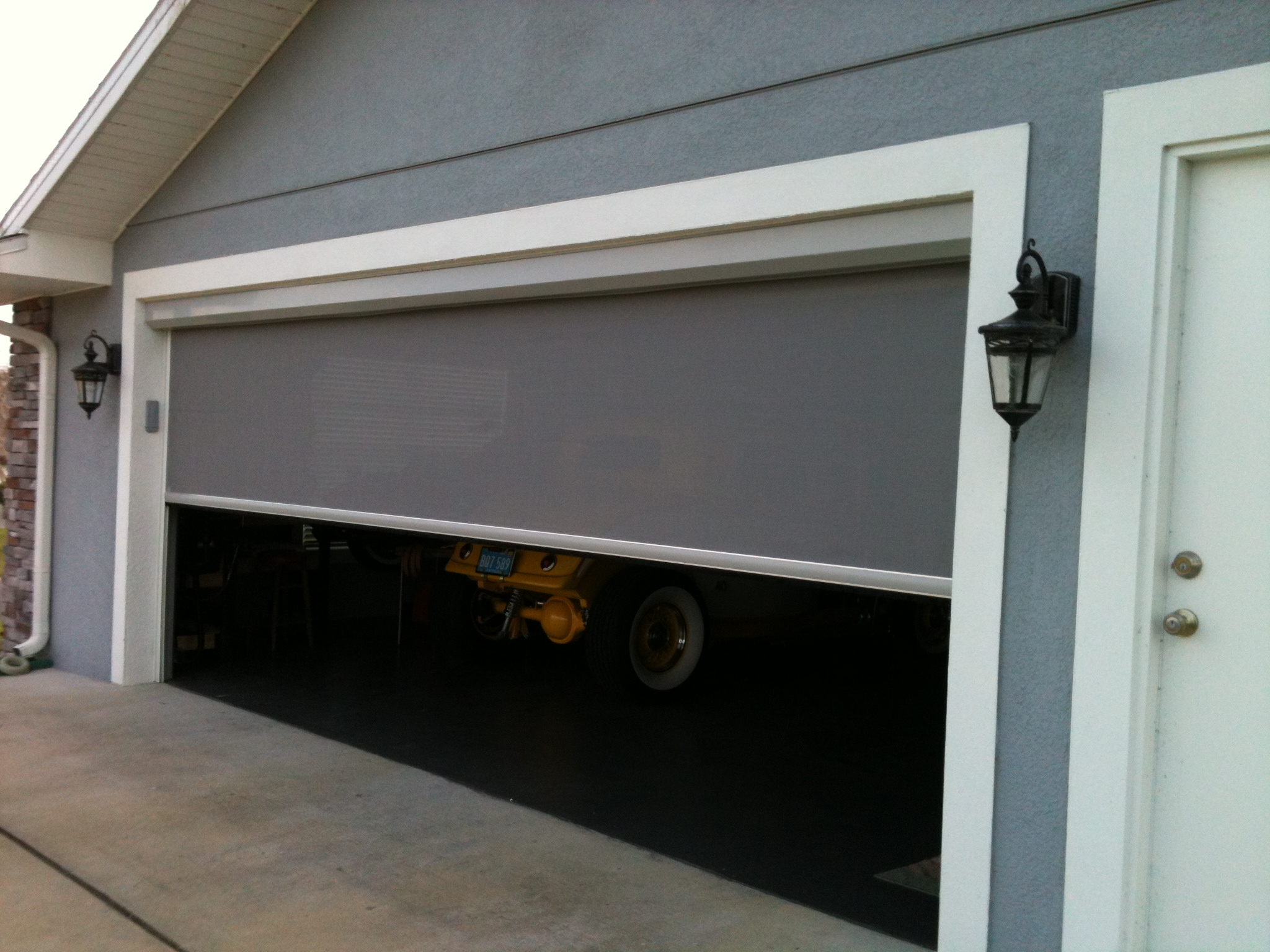 Screen garages patios screen concepts for Motorized garage door screens